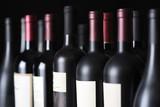 Row of vintage wine bottles - 211705694