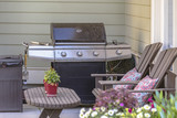 Beautiful BBQ area with seating and coffee table - 211707419