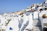 Famous stunning view of white architectures and colorful houses above the volcanic caldera in the village of Oia in Santorini island, Greece - 211714061