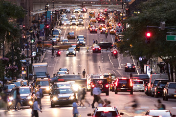 Busy evening cityscape with cars and people on 42nd Street in Midtown Manhattan New York City