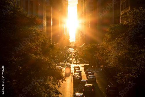 Sunset between the buildings on 42nd Street in Manhattan New York City - 211714448
