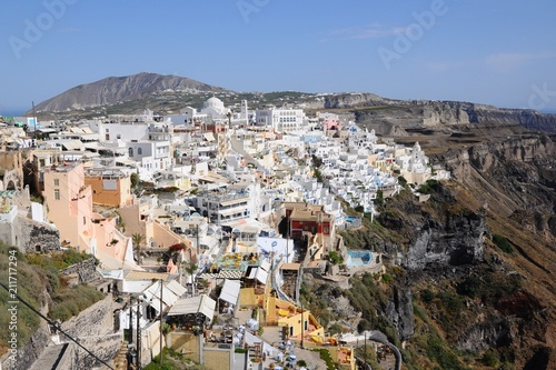 Famous stunning view of white architectures and colorful houses above the volcanic caldera in the village of Thira in Santorini island, Greece - 211717294