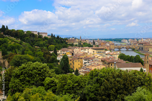 Florence cityscape with green trees, Italy. Concept of summer cheap tours to Europe. - 211724452