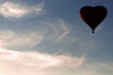 Red hot air balloon in the shape of a heart fly in sky. Love, honeymoon and romantic travel concept - 211737435