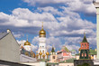 Beautiful view of the architectural ensemble of the Moscow Kremlin with blue cloudy sky and domes of temples
