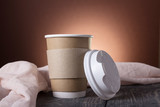 Cup-thermos with lid for coffee to take away, on background of wooden table - 211747295