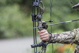 A Compound Bow and arrow drawn close up. - 211752898