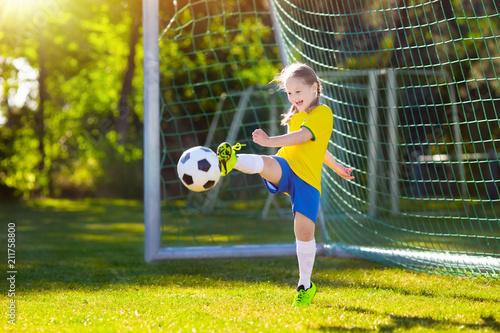 Leinwanddruck Bild Brazil football fan kids. Children play soccer.
