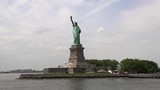 Wide close view passing by the Statue Of Liberty by boat on a sunny summer day. - 211759883