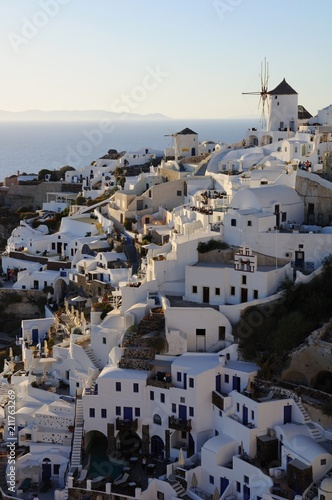 Fotobehang Santorini Famous stunning view of white architectures and windmills above the volcanic caldera in the village of Oia in Santorini island, Greece