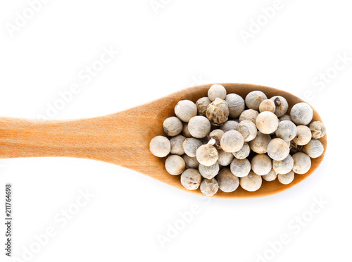Pepper seed in wood spoon  on white background - 211764698