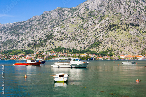 Plexiglas Khaki Nature landscape in boka-kotor bay with boats in the water, old european city Kotor surrounded mountains in Adriatic sea coastline, Montenegro