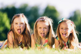 Three little girls sticking their tongues out - 211771633