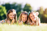 Three little girls showing OK with their hands. - 211771665