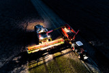 Combine working on the field in the night