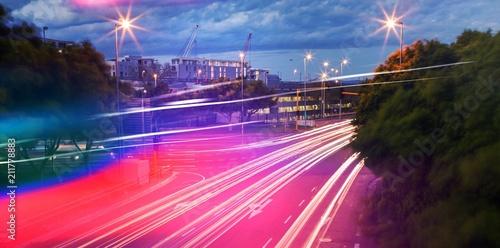 Light trails on city street - 211778883