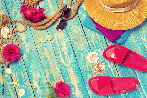 Bright composition of female  beach accessories on blue wooden background - 211779458