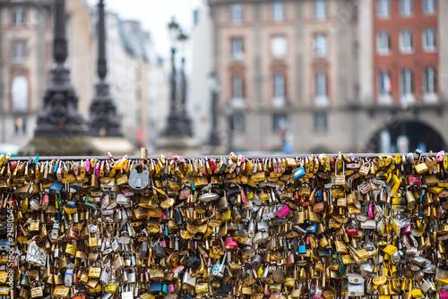 Love padlocks at Pont de l'Archeveche in Paris. The thousands of locks of loving couples symbolize love forever.