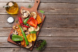 Grilled vegetables on cutting board - 211819478
