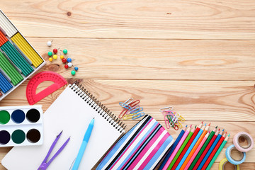 School supplies on brown wooden table © 5second