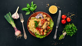 Bulgur with meat, paprika, cherry tomatoes, and vegetables. On a wooden background. Top view. Copy space. - 211833803