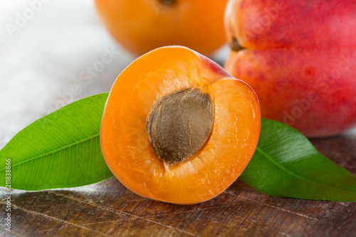 Fresh apricots on a white wooden background. - 211838866