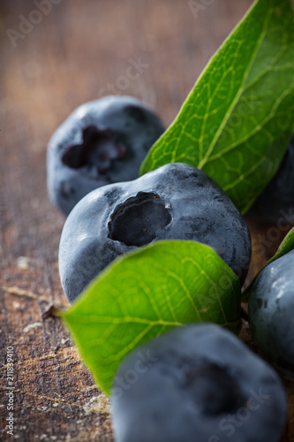 Fresh Blueberries on wooden table. - 211839410