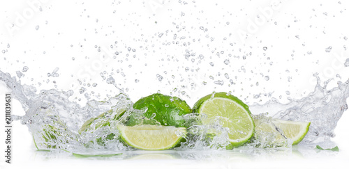 Fresh limes with water splash over white background. - 211839631