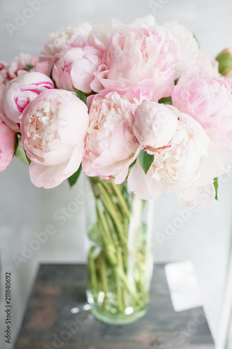 Floristry concept. Bouquet of beautiful flowers on gray table. Spring colors. the work of the florist at a flower shop.