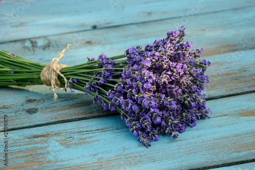 Bouquet of lavender on a blue old wooden table in the style of Provence.