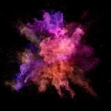 Explosion of coloured powder on black background - 211844027