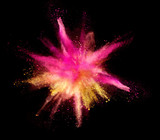 Explosion of coloured powder on black background - 211844035