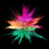 Explosion of coloured powder on black background - 211844093