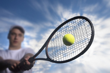 Tennis player hitting ball with backhand