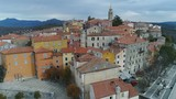 Beautiful aerial view flying over rooftops of historic center of Labin town in Croatia - 211844465