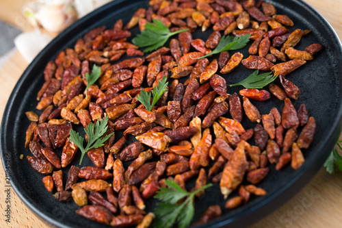 Red small chili pepper dried close up - 211845266