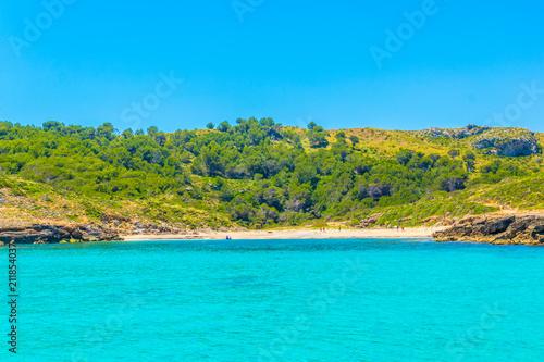 Fotobehang Turkoois bay with a beach near cap Farrutx at Mallorca, Spain