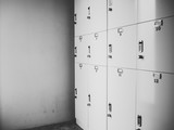 Rows of gray small lock boxes in lockers room. - 211864820