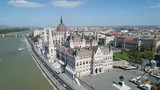 Drone flight past the massive Hungarian Parliament Building, located on the Danube river in Budapest, historic architecture Europe - 211868074