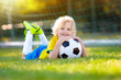 Leinwandbild Motiv Brazil football fan kids. Children play soccer.