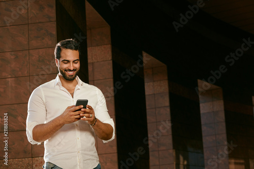 Man With Mobile Phone Outdoors