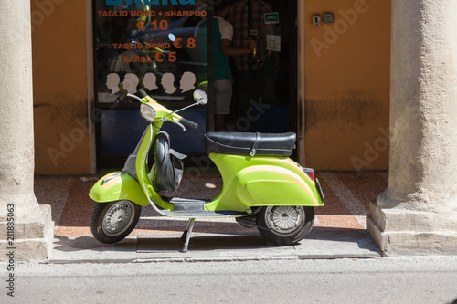 Bologna ITALY July 2018 - vespa special - old italian vintage scooter in front a hair style shop - italian style