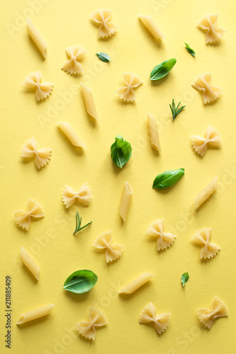 various pasta on yellow background - 211885409