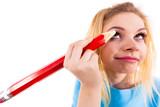 Woman painting eyebrows using regular pencil - 211893637