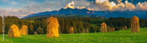 Fototapeta spring panorama of the Tatra Mountains in Poland during the sunset, stacks of hay after haymaking