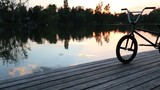 Smooth gimbal shots of a bmx in sunset - 211900051