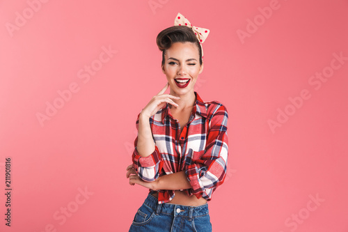 Happy young pin-up woman isolated