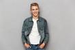 Leinwanddruck Bild - Portrait of a smiling casual teenage boy