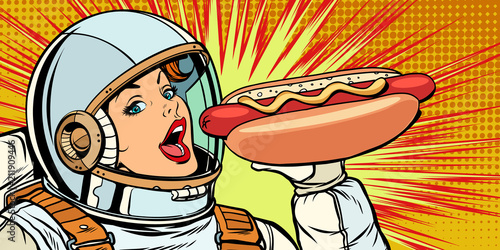 Hungry woman astronaut eating hot dog sausage - 211909446