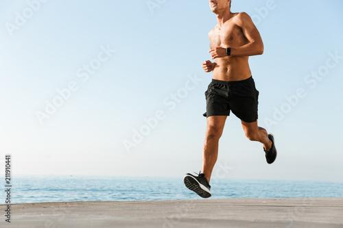 Aluminium Fitness Cropped image of shirtless sportsman running